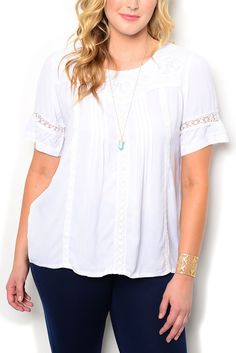 http://www.dhstyles.com/White-Plus-Size-Dressy-Sheer-Flowy-Paneled-Floral-p/ire-7701x-white.htm