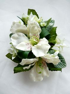Lapel corsage featuring ivory alstromeria with complimenting foliages and bow trim.
