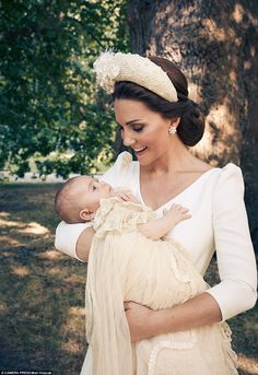 Kate, 36, could be seen gazing into the infant's eyes as she held him in the gardens of Clarence House after the ceremony