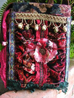 This is a small boho gypsy bag. Handmade with thick textured floral tapestry fabric and recycled red panne velvet fabric. Embellished with sage