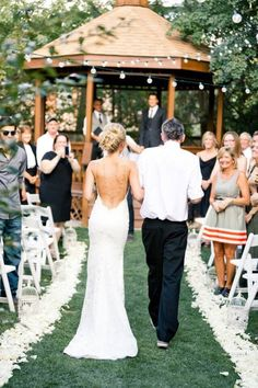 Backless wedding dress. Walking down the aisle.