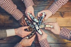 Fun pre-wedding shot of the groomsmen with their flasks   Photo by Paco & Betty