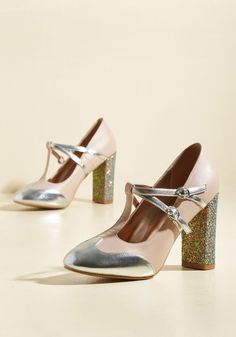 <p>These mint heels demand an automatic sashay when worn, for they make you feel oh-so-sassy! Trimmed in gold accents, fastened by twin buckled straps, and supported by glittery block heels, these unexpectedly chic T-straps by Banned give off vogue vibes, transforming the sidewalk into your own personal runway.</p>