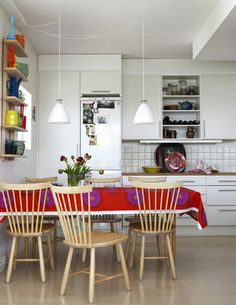 superb Scandinavian eat in kitchen with marimekko fabric as tablecloth   Photographer Patric Johansson