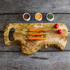 One of our larger olive wood boards with natural bark edges for that rustic charm in your kitchen. As with all our boards you can carve meat and cut vegetables, fruit, herbs and fish. We do recommend that you use different boards for meat and veg, or keep one side for each food type. Makes a great gift for any occasion. These do have a wow factor and look fantastic in any kitchen. Rustic items work brilliantly in modern kitchens and give your home that in-trend Nordic style.
