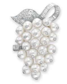 Pearl and diamond Groseilles brooch designed as a bushel of pearl currents mounted in platinum by René Boivin