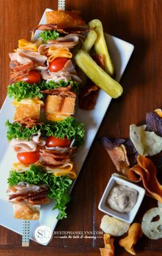 Cold Cut Sandwich Skewer Ideas...Love this! What a great way to serve sandwiches at a party or even fun to pack on a picnic....