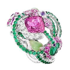 By Faberge! Let this Secret Garden ring hypnotise you with its exuberant 7.13 carat pink sapphire surrounded by emerald and diamond branches and nephrite leaves.