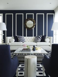 traditional crisp blue and white room with geometric walls and rug