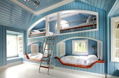 Four beds in wall. Love it! Would be a really pretty place to have kids sleep in at a beach house