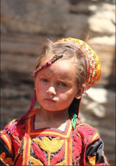 Kalash girl in Pakistan - The Kalash people are also known as The Lost Children Of Alexander The Great. There are an estimated 3,000 Kalasha left in this beautiful tribe, and they have maintained their ancient culture and tribal rites for well over 2,000 years. Part of these rites include the making of distilled spirits and smoking marijuana. Rites that would be a death sentence in the religion of Islam. These rites are protected by a fierce tribal leader who enforces strict policies.