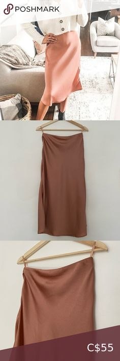 Silky dusty rose midi skirt Mid length skirt Never worn Silk like but no material tag Size small Zipper on side plus elastic waist band Beautiful fabric Picture 1 is best example of colour!! Skirts Midi Ankle Length Skirt, Mid Length Skirts, White Midi Skirt, Pleated Midi Skirt, Pink Leather Skirt, Scoop Bikini Top, Animal Print Skirt