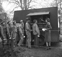 """""""A taste of war life: American GIs waiting in line for a Red Cross coffee wagon (November 1942). Photograph by Toni Frissell."""" #vintage #1940s #WW2"""