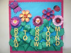 "Spring summer library bulletin board. ""Read to grow your mind"". Flower bulletin board."