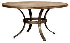 This dining table is sure to become a cherished family heirloom. The base of the table is handmade of wrought iron and finished in antiqued pewter. The top features tongue-and-groove hardwood with...