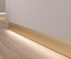 Baseboard / porcelain stoneware / backlit TECHNAL GOLD RODAPIE ALEA