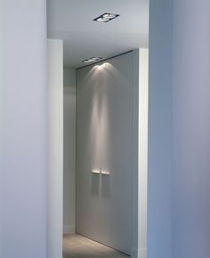 White interior with recessed lighting by Delta Light _