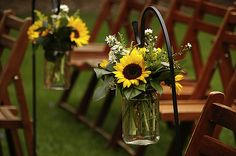 Shepherd's Hooks with Mason Jar Vases... i would do some type of spring or hawian flower