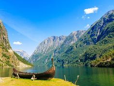 Tourism and travel. Mountains and fjord Sognefjord in Norway, Scandinavia. Old viking boat on seashore. Norway Fjords, Us Destinations, Arctic Circle, Small Towns, Places To Travel, Travel Inspiration, Tourism, Around The Worlds, Cruise Sale