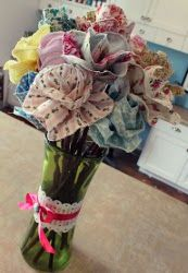 Pretty fabric flowers. Make a bouquet from leftover fabric in your stash. #sewing #fabricflower