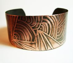 Cuff | Kim from Among The Ruins Designs.  Etched copper with patina.