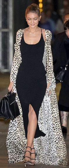 Who made  Gigi Hadid's black dress, leopard coat, handbag, jewelry, and sandals?