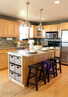 I am obsessed with this kitchen - the backsplash, lights, countertops, appliances, stools, baskets, all of it.