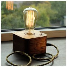 A wooden lamp designed for retro EDISON light bulbs.The lamp is made by hand from natural wood, polished and coated with Danish oil.Natural Oak.  DETAILS - Base Dimensions: 12cm*12cm*7,5cm(4,8*4,8*3 inch) -Full height - 19,0cm (7,6 inch) - Cord Length: 150cm(60 inch) (european-type plug), for US users, Canada and Australia comes bundled with plug adapter - 40 watt Edison bulb INCLUDED in the PACKAGE!! - E27 base | 60 watt max Payment Policy I accept only PayPal. If you dont have a PayPal…