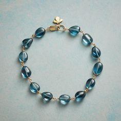 Mariana Bracelet: London blue topaz nuggets parade their depth of hue in this 'Mariana' bracelet. Ananda Khalsa adds a trefoil charm buffed to a matte finish. Handmade in USA. Love Bracelets, Handmade Bracelets, Jewelry Bracelets, Jewelery, Handmade Jewellery, Bangles, Wood Bracelet, Strand Bracelet, Pearl Bracelet