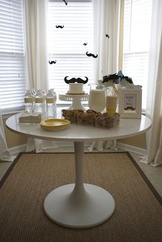 Simple milk and cookies dessert table complete with flying mustaches, of course!