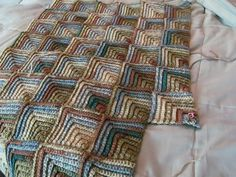 Mitered squares blanket, free pdf crochet pattern by Bernat.  Squares don't have to be done separately & then joined with this pattern.  I like the effect of using variegated yarn with this.
