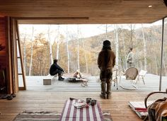 Even in cold weather, they open the sliding doors to let the fresh air in. Photo by: Dean KaufmanCourtesy of: Dean Kaufman 2010 Japanese Mountains, Farnsworth House, Wood Patio, Boutique Homes, Wood Interiors, Wood Doors, Barn Doors, Custom Wood, The Fresh