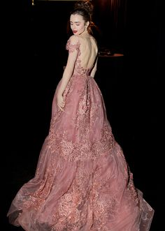 Lily Collins in a Zuhair Murad Couture dress and Harry Winston jewelry // Celebrity inspiration for wedding gowns and dresses from the Golden Globes 2017 red carpet