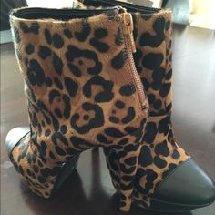 Jessica Simpson cheetah print booties Jessica Simpson high heel cheetah print booties. Only worn once and unfortunately they got scratched. Other than the scratches, they are super cute and very comfortable. Size 8. Willing to hear out reasonable offers. Jessica Simpson Shoes Ankle Boots & Booties