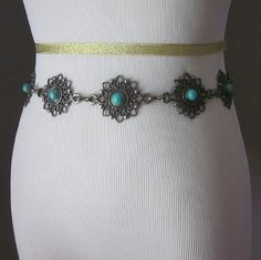 Turquoise and silver belt Excellent condition! Unique and cute! Adjusts from 28.5 inches to 42 inches.  Bundle for best deals! Hundreds of items available for discounted bundles! You can get lots of items for a low price and one shipping fee!  Follow on IG: @the.junk.drawer Accessories Belts