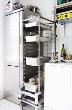 Rolling rack can move from pantry to kitchen bringing tools &/or ingredients into the kitchen when needed & then return to pantry.