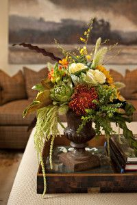 silk arrangement with protea, artichoke, seed pods and florals