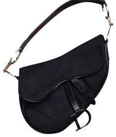 d785a2f109b8 I m thinking about selling my Dior Saddle bag in black canvas with silver  hardware