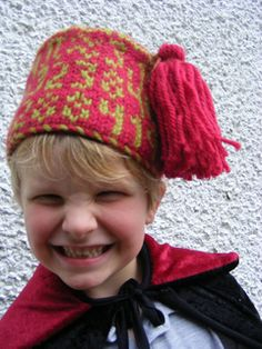 Because You Can Never Have Too Much Pi - Pi to 50 decimal places appears on the crown of this hat. The pattern makes a cozy beanie, or a fez if you felt it! Can be made in adult size.  Pi symbols on top of hat.  Fingerless mitts to match.  http://www.ravelry.com/patterns/library/pi-mitts