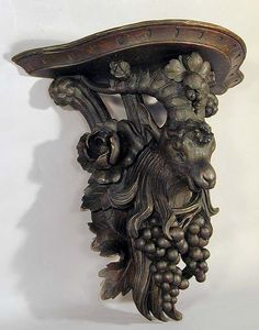 expressive carved wood ram shelf