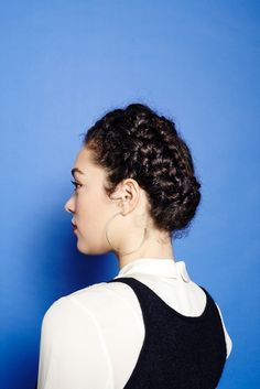 """This lovely cinnamon roll braid will keep your curls in place in the cutest way possible."" SO CUTE"