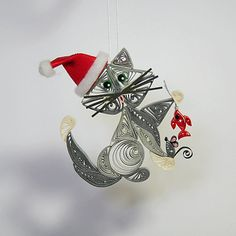 Santa's Helper Kitty Cat Hanging Ornament: Silver Gray Fur with Emerald Green Eyes and Red Santa's Hat. Hanging a Gold Fish with Gray Mouse....