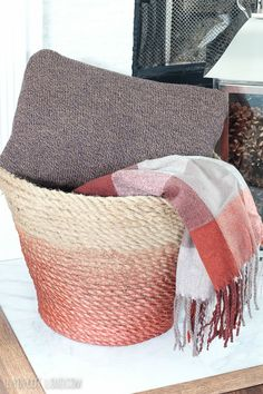 Such a beautiful DIY Rope Basket - I love it with the throw blanket and pillow in it.