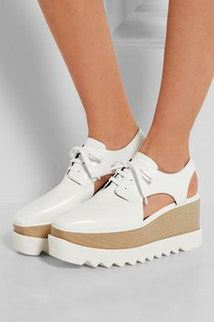 Wooden heel measures approximately 75mm/ 3 inches with a 60mm/ 2.5 inches platform White faux leather Lace-up front Made in Italy