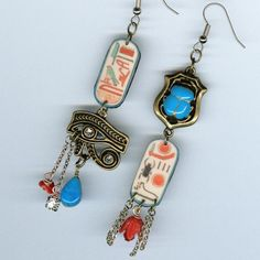Egyptology Asymmetrical Earrings Egyptology is the study of ancient Egyptian history, language, literature, religion, architecture and art from