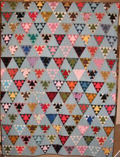 quiltsbycheri: antique flat irons quilt has triangles within triangles within more triangles. This pattern would surely take lots of careful cutting and time to make, but isn't it something very special!