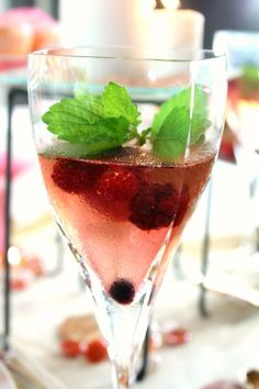 Mixed berry sangria garnished with lemon balm #recipe #cocktail #sangria