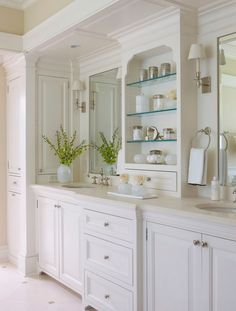 Chic, elegant master bathroom design with white & black Victorian penny tiles floor, white bathroom cabinets with marble counter tops, double sinks and polished nickel faucets. Bad Inspiration, Bathroom Inspiration, Cabinet Inspiration, All White Bathroom, White Bathrooms, Small Bathroom, Luxury Bathrooms, Bathroom Modern, Houzz Bathroom