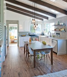 Long, practical kitchen with a slimmer table