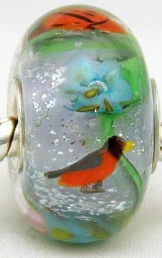 a cool bead with a robin and a ladybug
